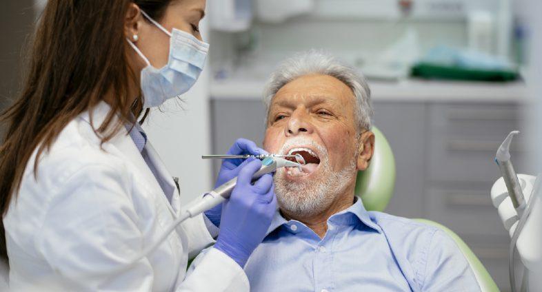 Senior-man-having-dental-checkup
